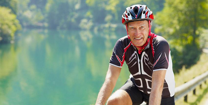 Older gentleman riding a bike